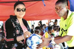 Mrs Giwa Signing on the Tournament Ball